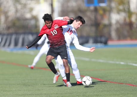 Somers' Max Grell (19) and Amityville's Henrey Martinez (10) fight for possession during their 2-1 loss to Amityville in the Class A boys state soccer final at Middletown High School in Middletown on Sunday, November 11, 2018.