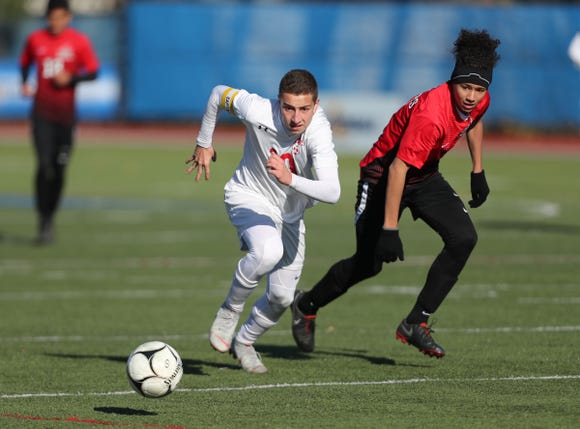 Somers' Lucas Fecci (10) chases a baall to the corner during their 2-1 loss to Amityville in the Class A boys state soccer final at Middletown High School in Middletown on Sunday, November 11, 2018.