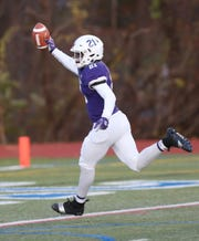 New Rochelle's Kayshaun Thomas (21) runs into the end zone after catching a first half touchdown pass against Newburgh  during the Class AA regional championship game at Mahopac High School Nov. 9, 2018.