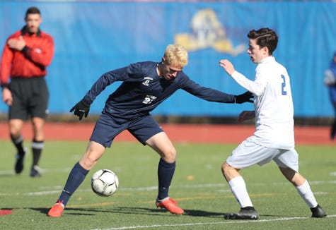Briarcliff's Alex Benson (21) works the ball against Westhill's Patrick Bogan (2) during their 1-0 loss to Westhill in the Class B boys state soccer final at Middletown High School in Middletown on Sunday, November 11, 2018.