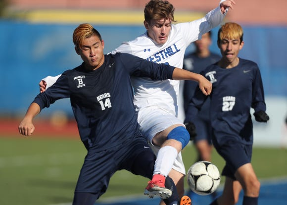 Briarcliff Chris Li (14) fights for possession during their 1-0 loss to Westhill in the Class B boys state soccer final at Middletown High School in Middletown on Sunday, November 11, 2018.