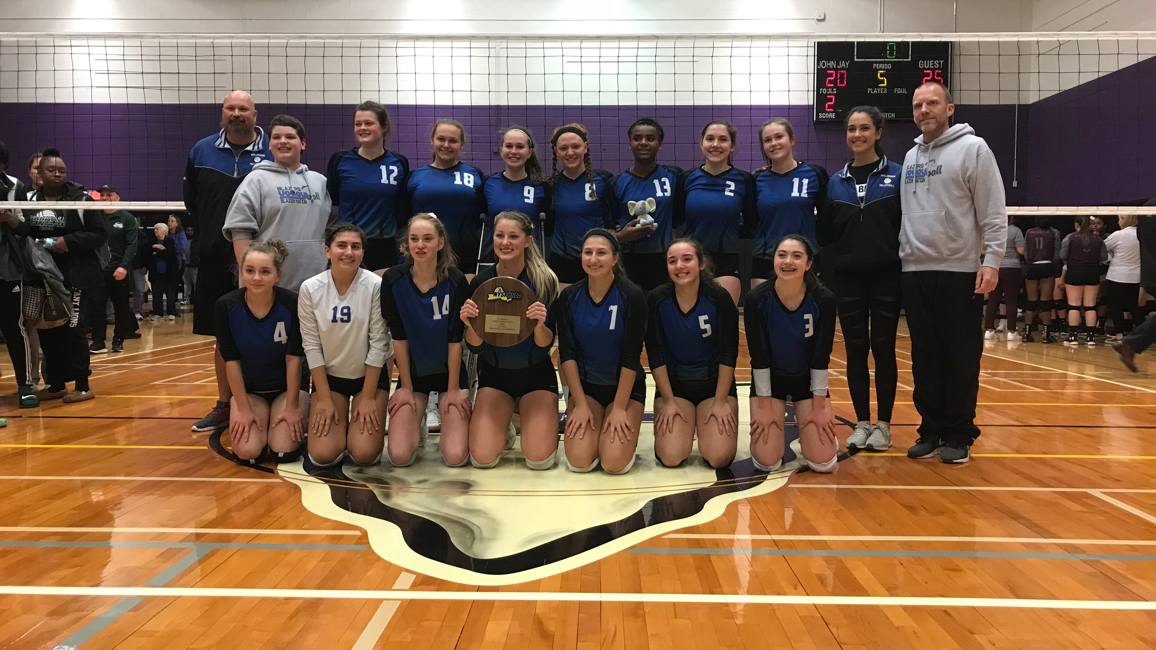 Millbrook poses with its Class C regional championship after defeating Valhalla in a five-set final at John Jay-Cross River. Nov. 10, 2018.