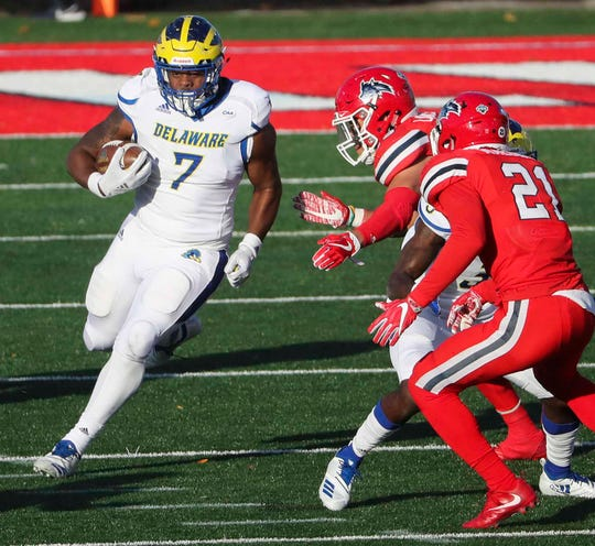 Delaware's Kani Kane takes off for a gain in the third quarter of the Blue Hens' 17-3 loss at Stony Brook Saturday.