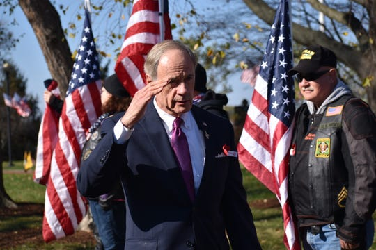 U.S. Sen. Tom Carper salutes veterans as he arrives at a ceremony unveiling a new Gold Star Families Memorial Monument at the Delaware Memorial Bridge. During the midterms, Carper contributed close to $225,000, a total matched nearly dollar for dollar by the national Democratic Party, to the state party