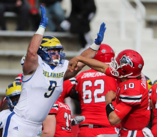 Delaware linebacker Troy Reeder charges at Stony Brook quarterback Joe Carbone in the first quarter at Stony Brook in 2018.