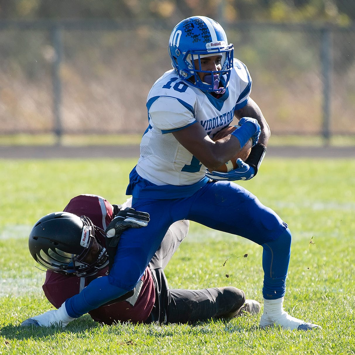 Middletown's Larry Griffin (10) is tackled by...