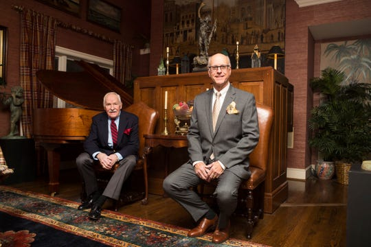 Bill Church, left, wears a blue Oxford shirt by Joseph A. Bank; silk regimental stripe tie by Brown & Church; navy blazer by Polo; grey slacks by Joseph A. Bank; black leather tassel slip-on loafers by Fratelli Rosetti; and red silk pocket square.  John Washburn wears a charcoal grey Ralph Lauren wool suit; white Joseph A. Bank  shirt; Land's End gold tie; and brown leather Cole Haan lace-up oxfords.