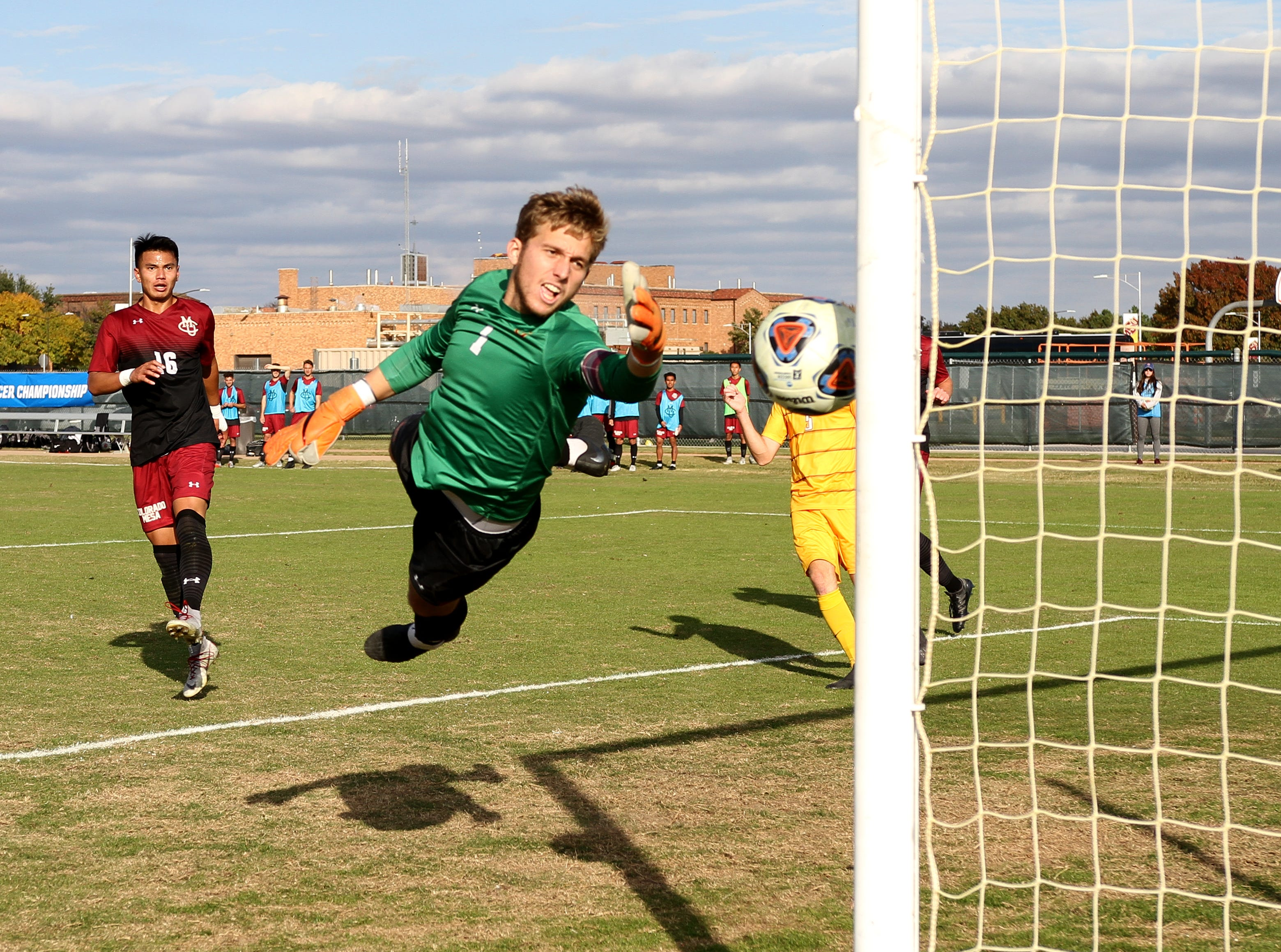Colorado Mesa's Briley Guarneri reaches as the ball hits the post Sunday, Nov. 11, 2018, in the second round of the NCAA Division II Tournament against Midwestern State at Stang Field. The Mustangs fell to the Mavericks 5-4 in penalty kicks.