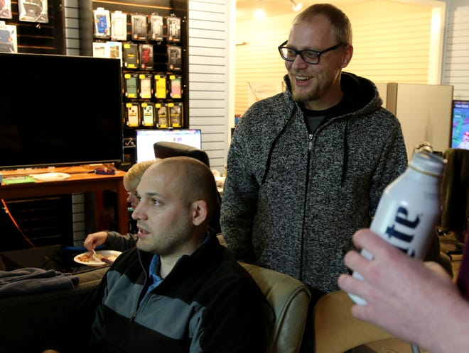 Walter Lambert plays Paperboy as Jake VanDouge watches at a gaming marathon to raise money for United Regional's Children's Miracle Network Saturday, Nov. 10, 2018, at MacTech Solutions.