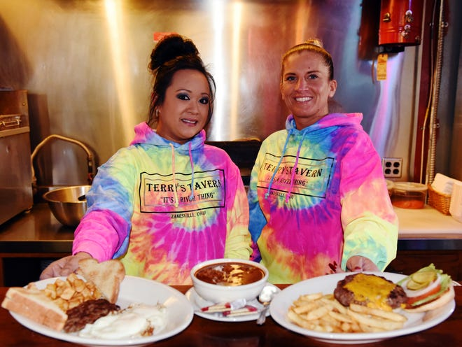 Bartenders Joanne Holanda, left, and Joslyn Kennedy stand with two of Terry's Tavern's most popular menu items, including its widely renowned chili and cheeseburger. One of Zanesville's staple establishments, it opens daily at 7 a.m. and serves until an hour before closing time.