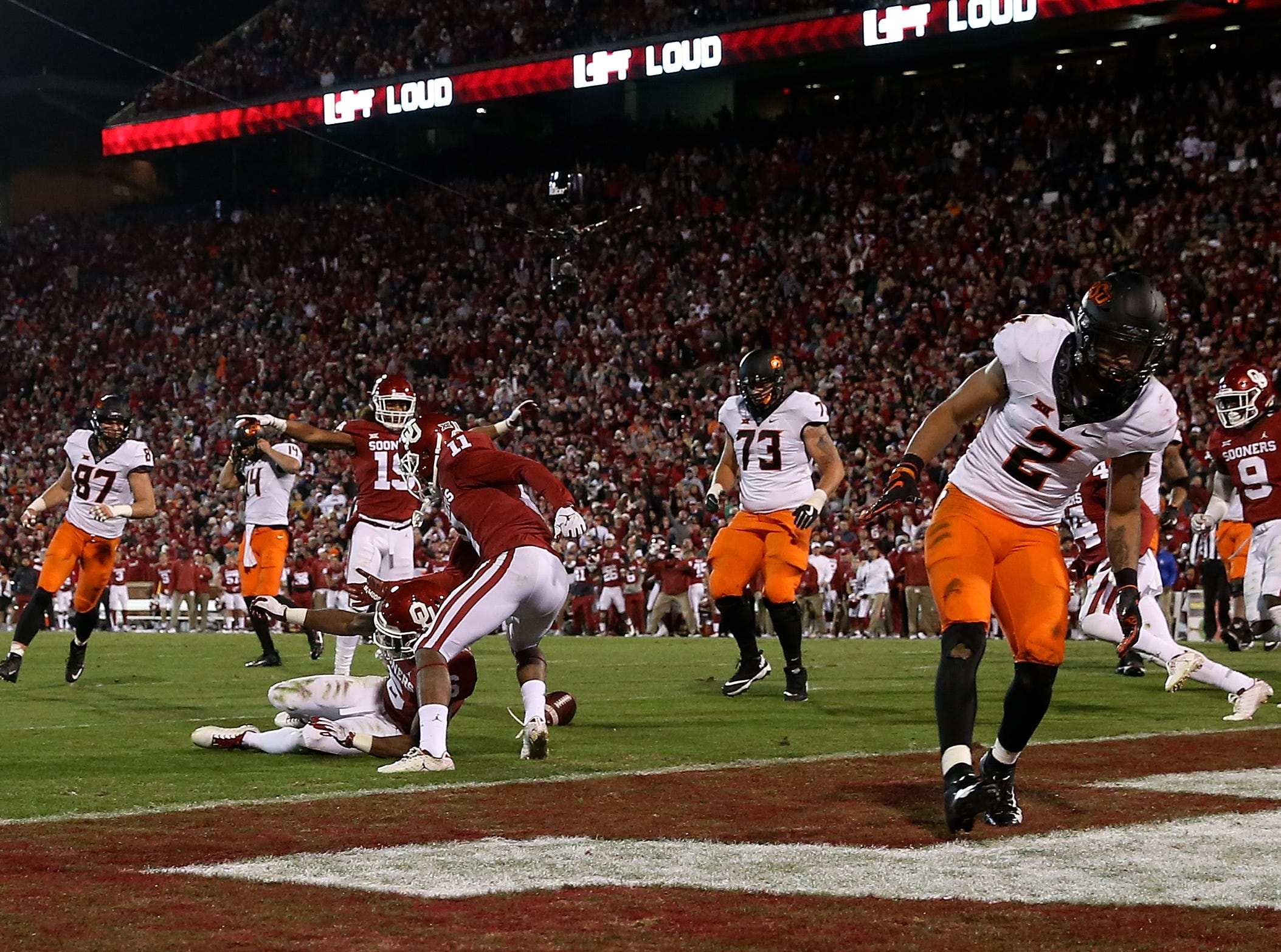 Oklahoma Sooners cornerback Tre Brown (6) defends a two-point conversion intended for Oklahoma State Cowboys wide receiver Tylan Wallace (2) during the fourth quarter at Gaylord Family-Oklahoma Memorial Stadium.