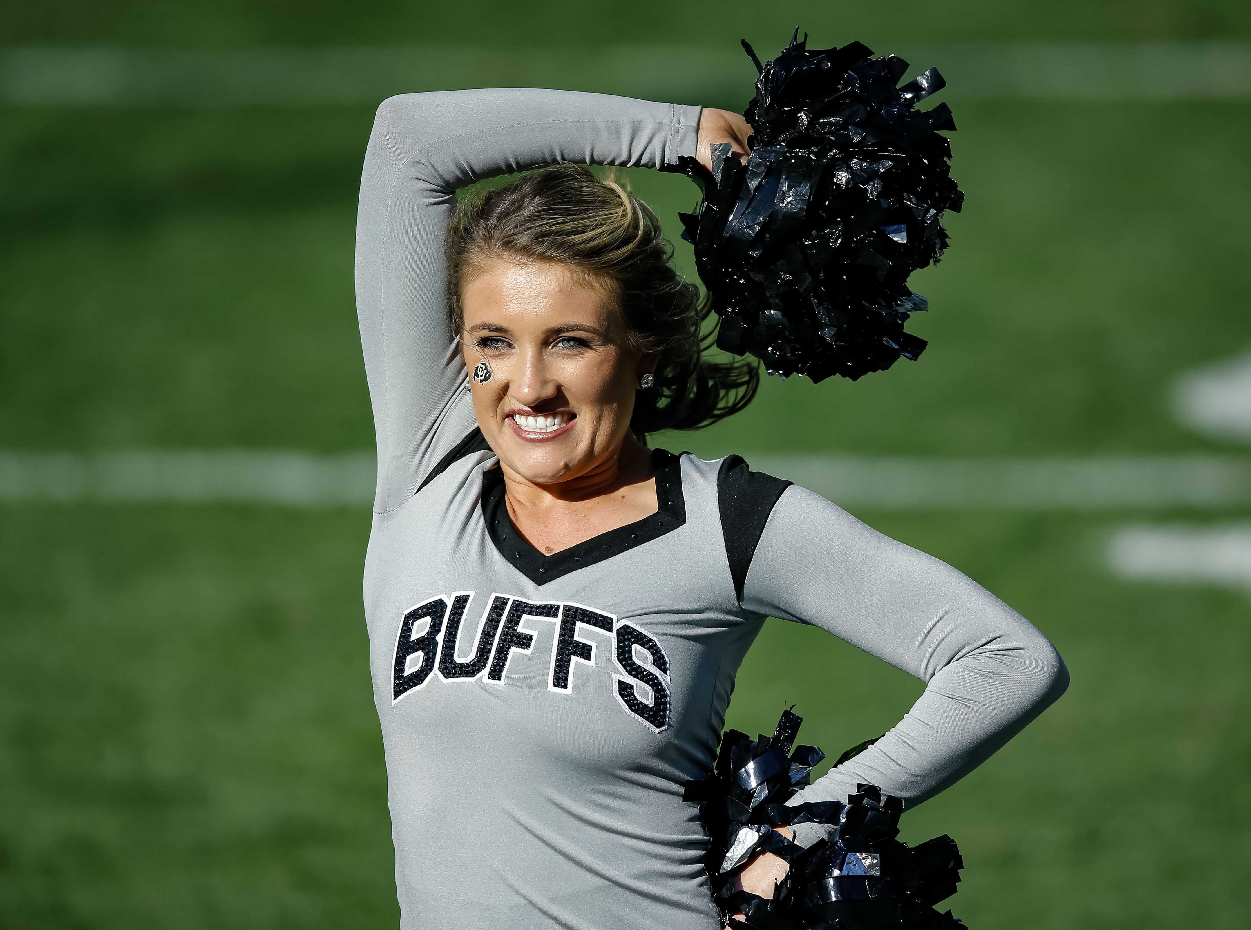 Week 11: A Colorado Buffaloes cheerleader performs before the game against the Washington State Cougars at Folsom Field.