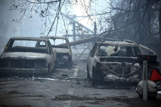 Abandoned and burned-out cars along Pearson Road following the Camp Fire in Paradise, California.