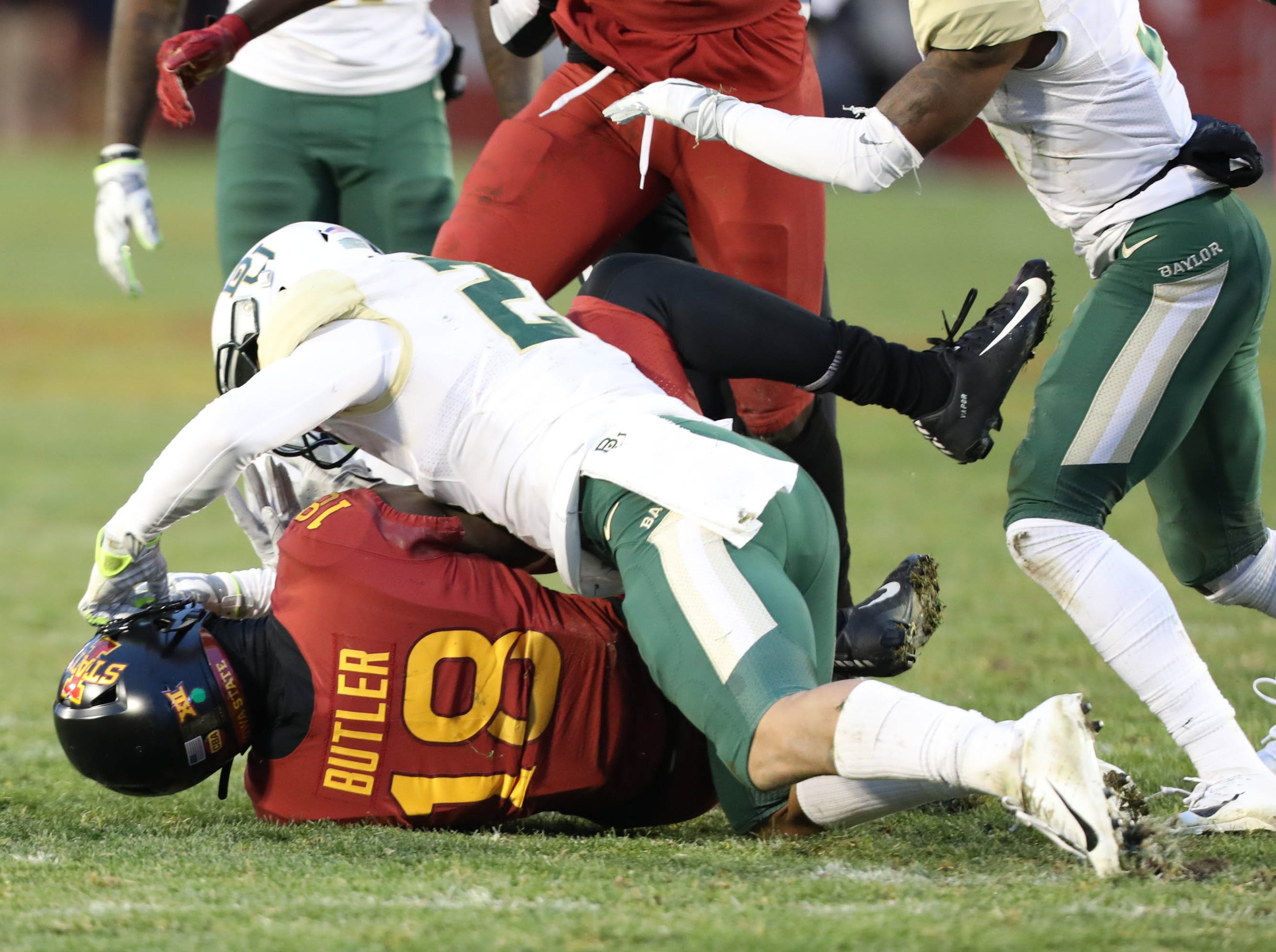 Iowa State Cyclones wide receiver Hakeem Butler (18) and Baylor Bears safety Blake Lynch (21) tangle during a brawl at Jack Trice Stadium.