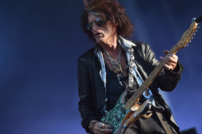 """Aerosmith guitarist Joe Perry is recovering in the hospital after collapsing following his performance with Billy Joel in New York's Madison Square Garden. Perry, 68, suffered """"shortness of breath,"""" a statement says."""
