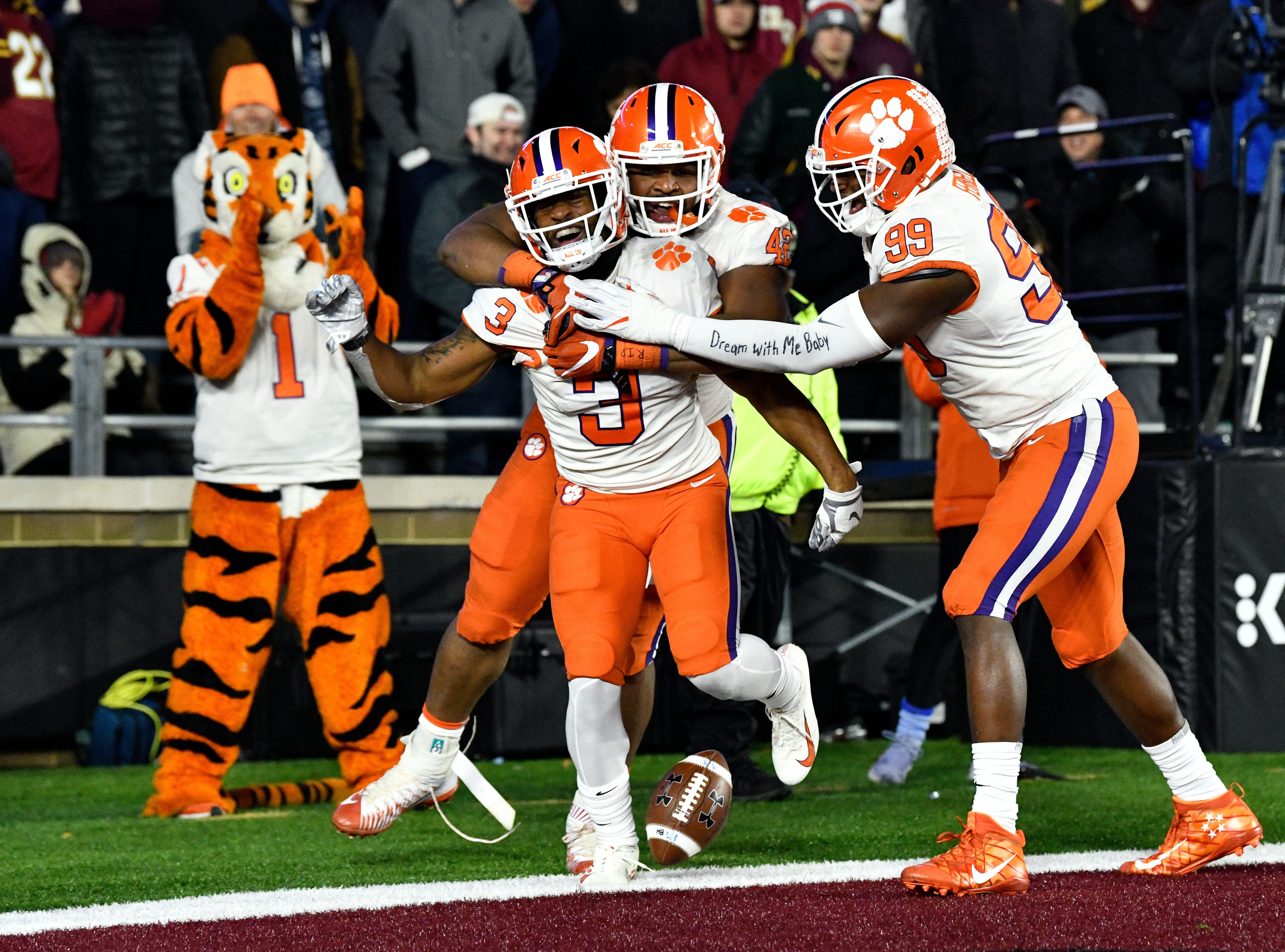Clemson Tigers wide receiver Amari Rodgers (3) celebrates with his teammates after scoring a touchdown on a punt return against the Boston College Eagles during the second half at Alumni Stadium.