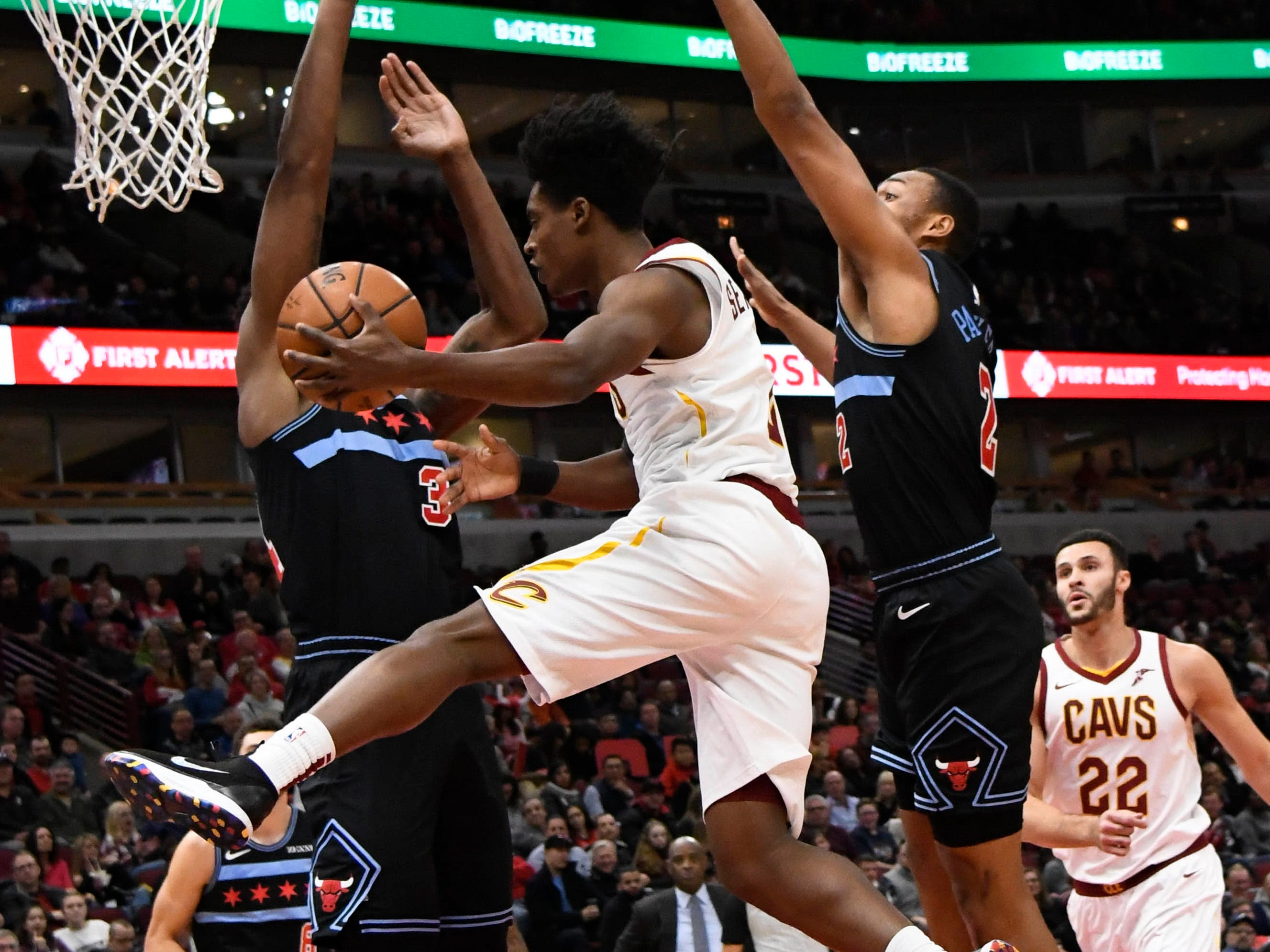 Nov. 10: Cavaliers guard Collin Sexton, center, tries to make a leaping pass around Bulls defenders Wendell Carter Jr., left, and Jabari Parker during the first half in Chicago.