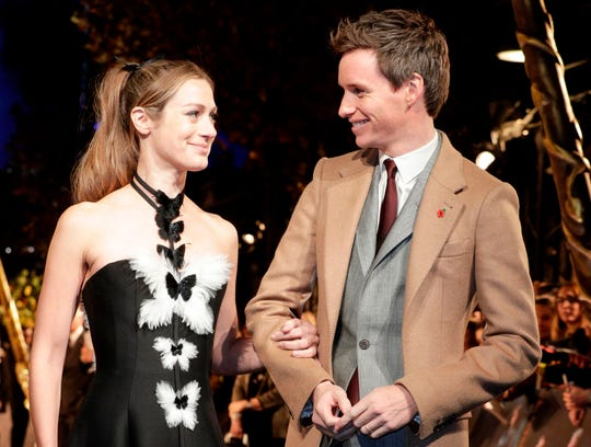 "Eddie Redmayne and his wife Hannah Bagshawe arrive for the Nov. 8 premiere of ""Fantastic Beasts: The Crimes of Grindelwald"" in Paris. The couple married in 2014."