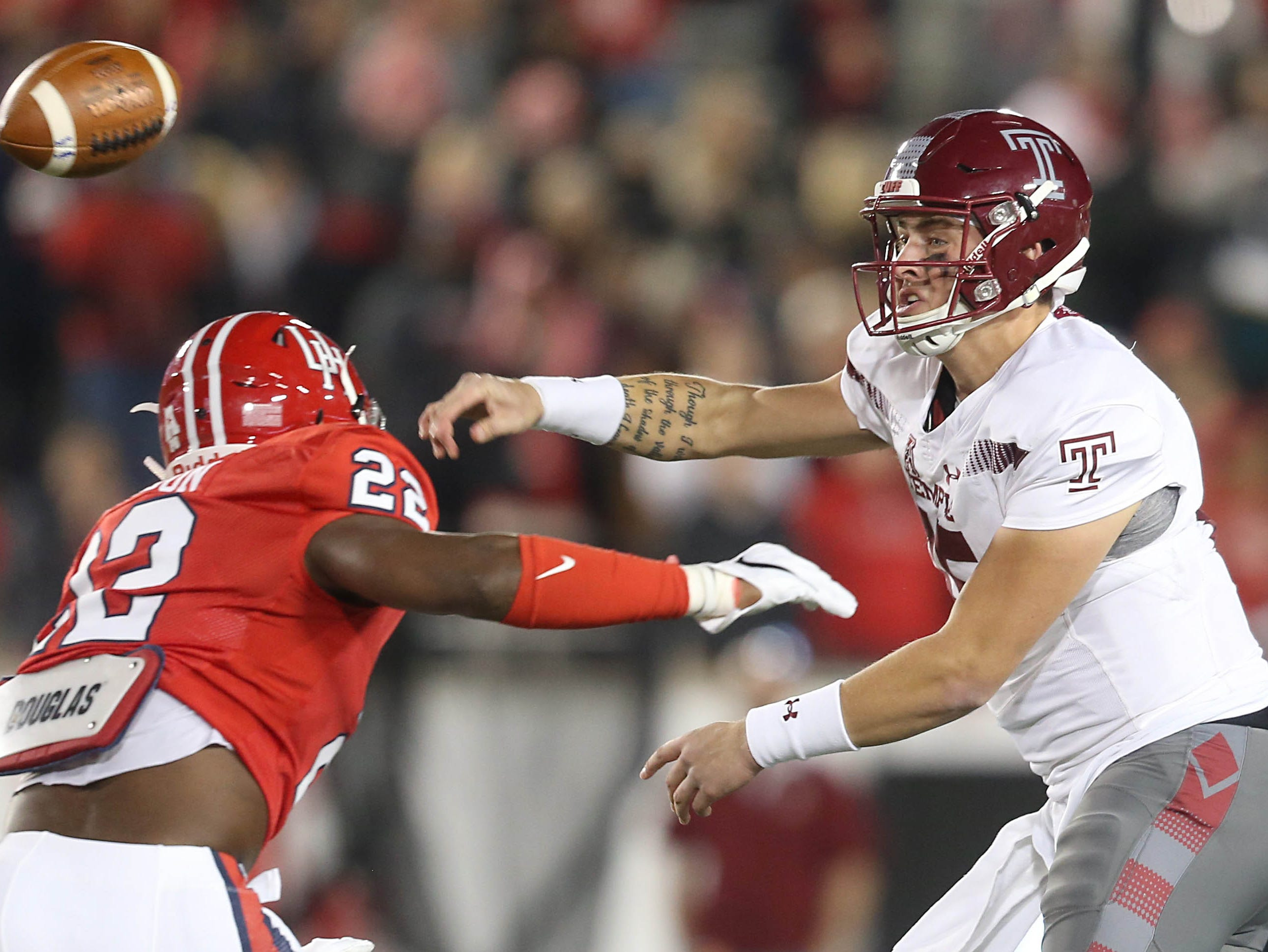 Temple Owls quarterback Anthony Russo (15) passes against Houston Cougars linebacker Austin Robinson (22) in the first half at TDECU Stadium.