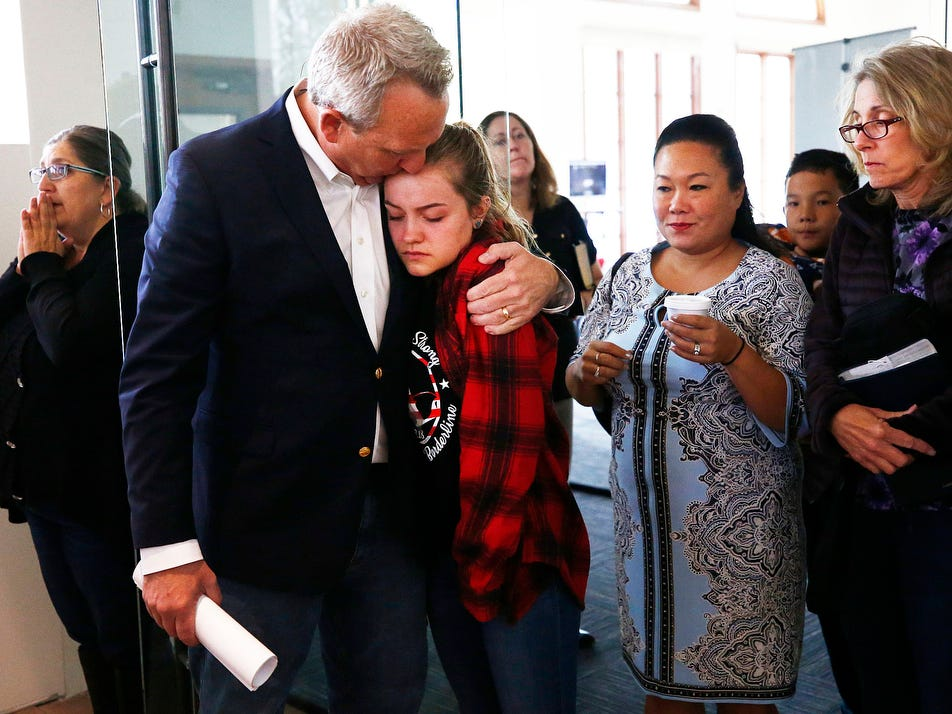 Thousand Oaks councilman and pastor Rob McCoy comforts his congregation during Sunday morning services at Godspeak Calvary Chapel on Nov. 11, 2018, in Newbury Park, Calif. Twelve people were shot and killed Wednesday by gunman Ian David Long who opened fire at the Borderline Bar and Grill.