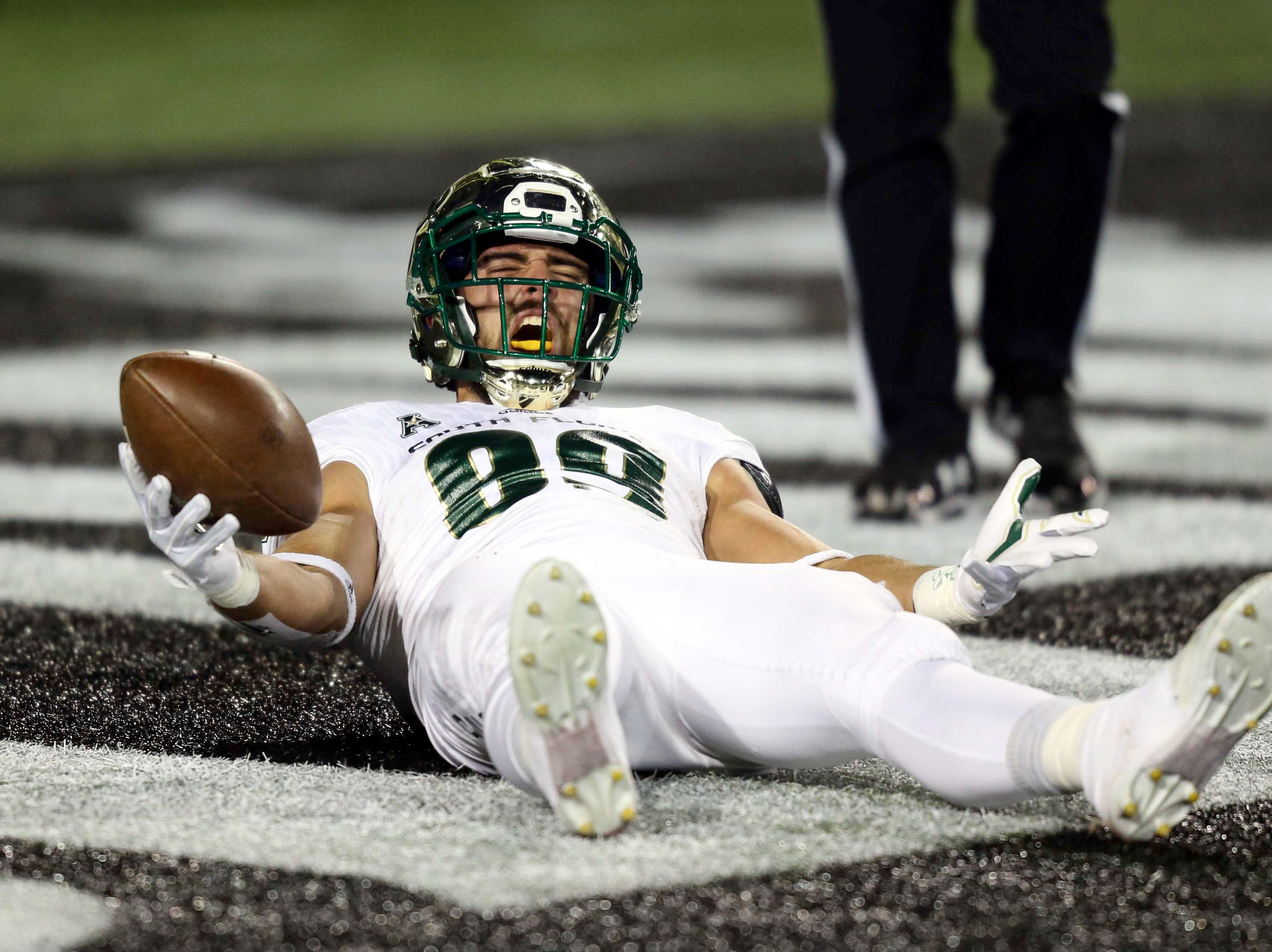South Florida Bulls tight end Mitchell Wilcox (89) reacts to scoring a touchdown against the Cincinnati Bearcats in the first half at Nippert Stadium.