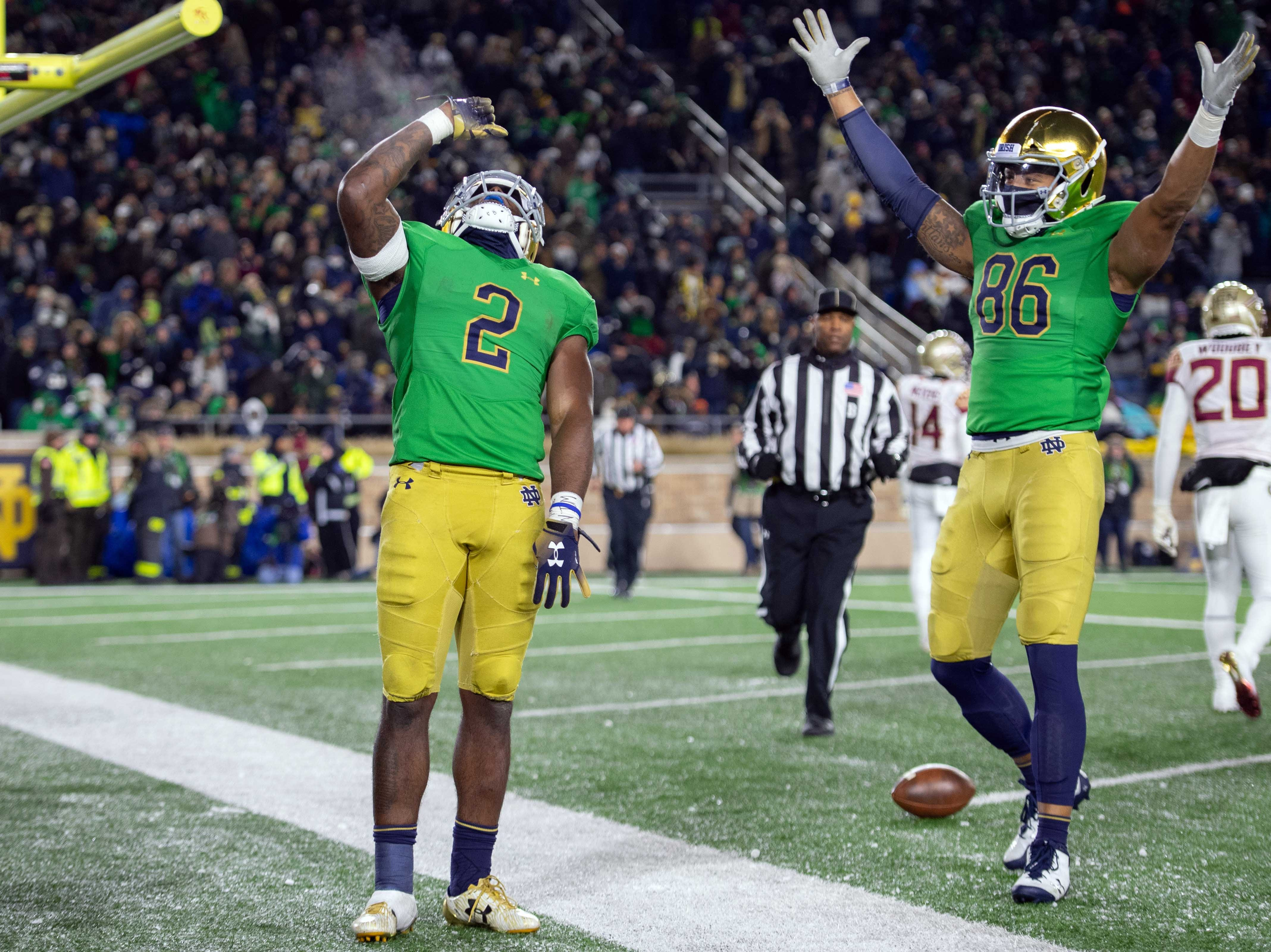 Notre Dame Fighting Irish running back Dexter Williams (2) and tight end Alize Mack (86) celebrate after Williams scored a touchdown in the fourth quarter against the Florida State Seminoles at Notre Dame Stadium.