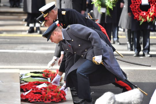 Prince William (from front), Prince Harry, Prince Andrew and Prince Edward lay wreaths at the Cenotaph during the Remembrance Sunday ceremony.