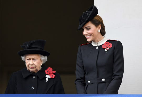 Queen Elizabeth II and Kate, Duchess of Cambridge, attend the annual Remembrance Sunday memorial at the Cenotaph in London.