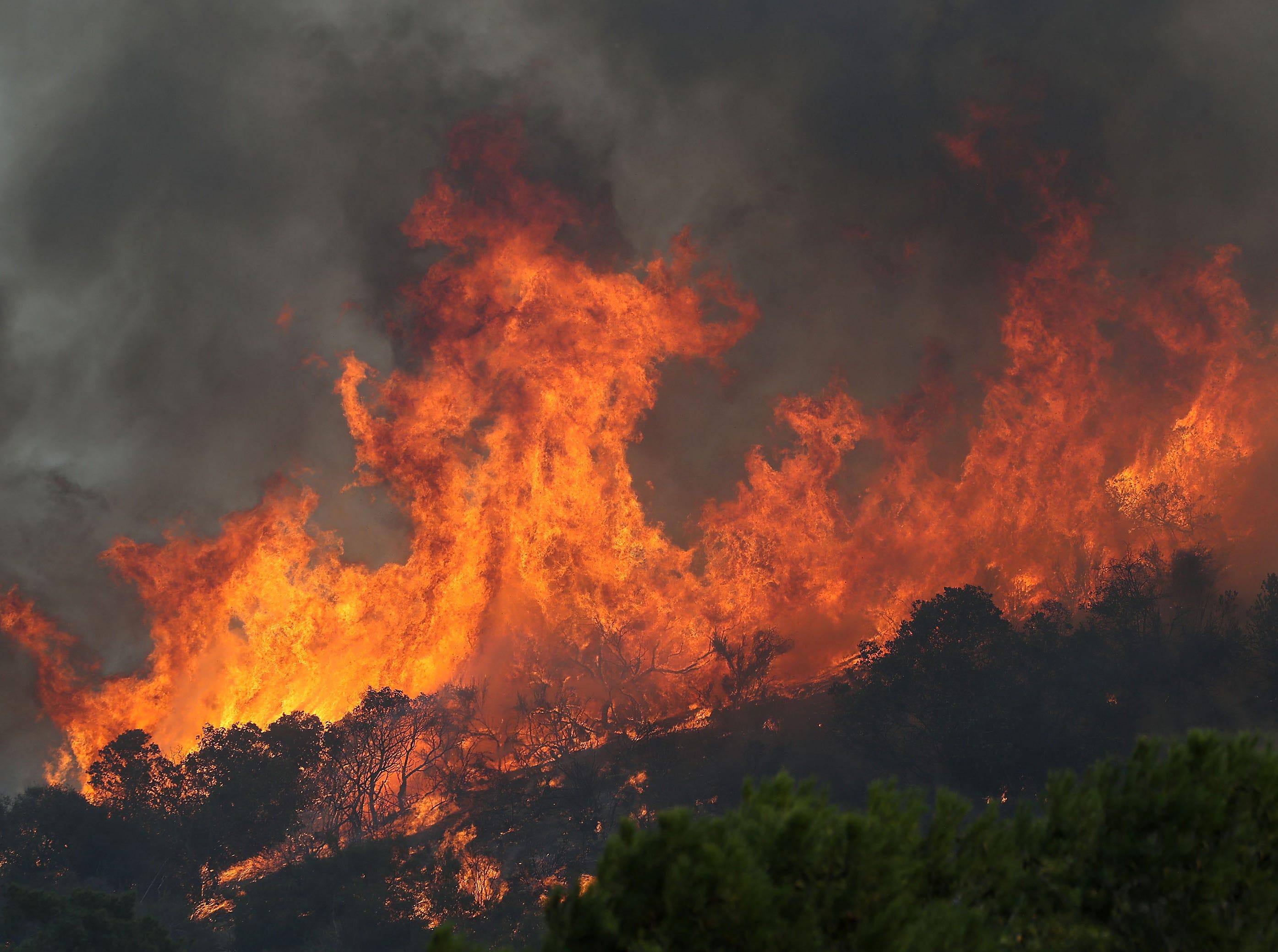Flames from the Woolsey Fire threaten hillside homes in Westlake Village, Ca., Nov. 9, 2018.