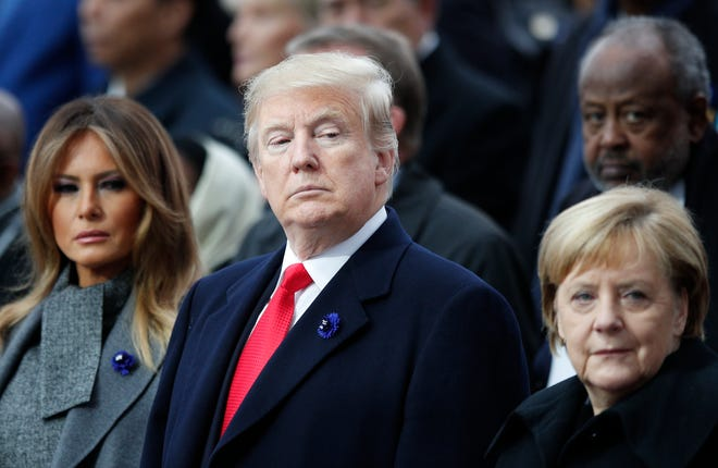 President Donald Trump, first lady Melania Trump, left, and German Chancellor Angela Merkel at the World War I commemoration in Paris on Sunday, Nov. 11, 2018.