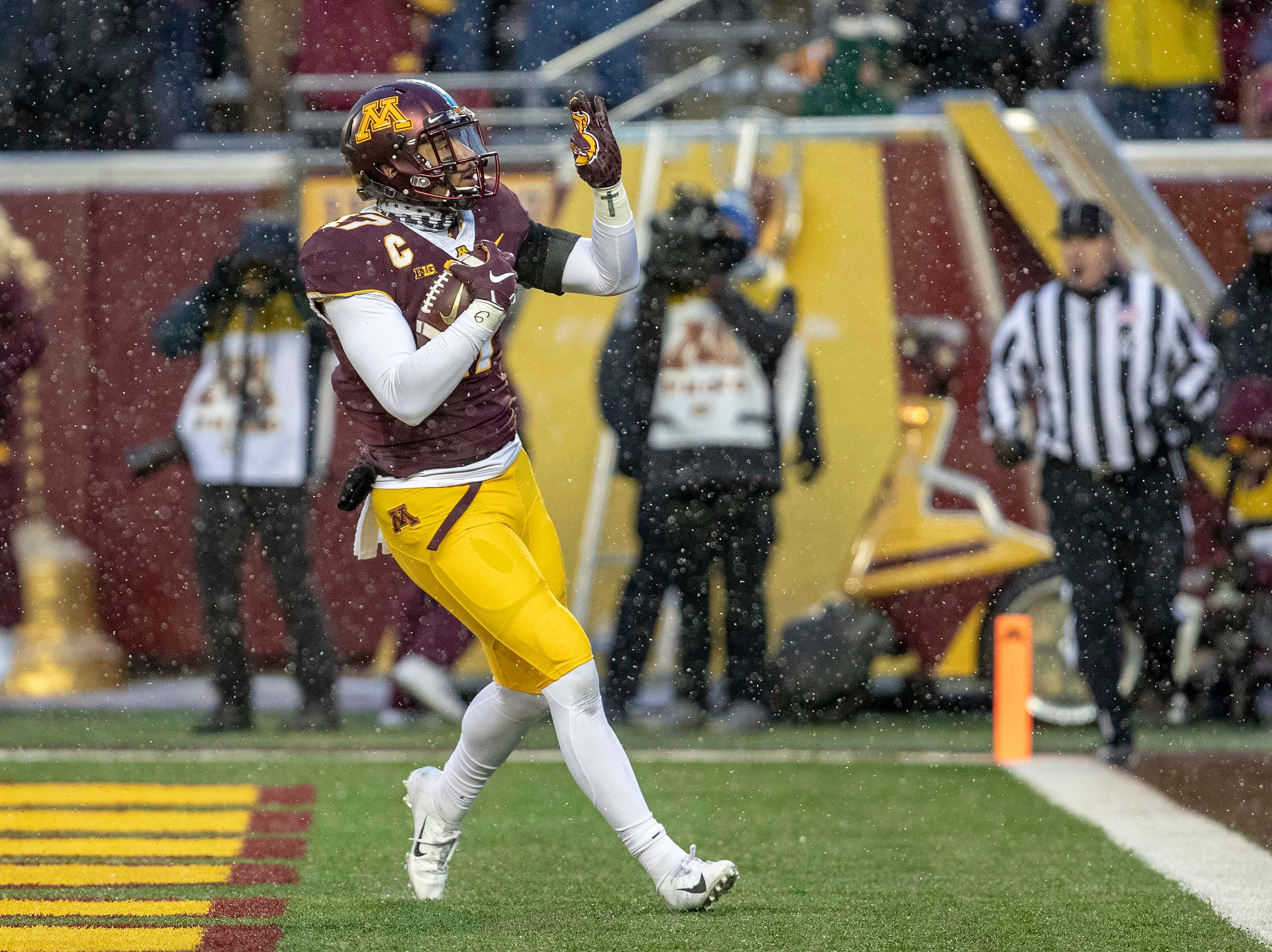 Minnesota Golden Gophers wide receiver Seth Green (17) celebrates after scoring a touchdown in the second half against the Purdue Boilermakers at TCF Bank Stadium.
