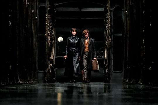 "Newt Scamander (Eddie Redmayne, right) must reconcile his feelings for Tina Goldstein (Katherine Waterston) as they fight evil in""The Crimes of Grindelwald."""