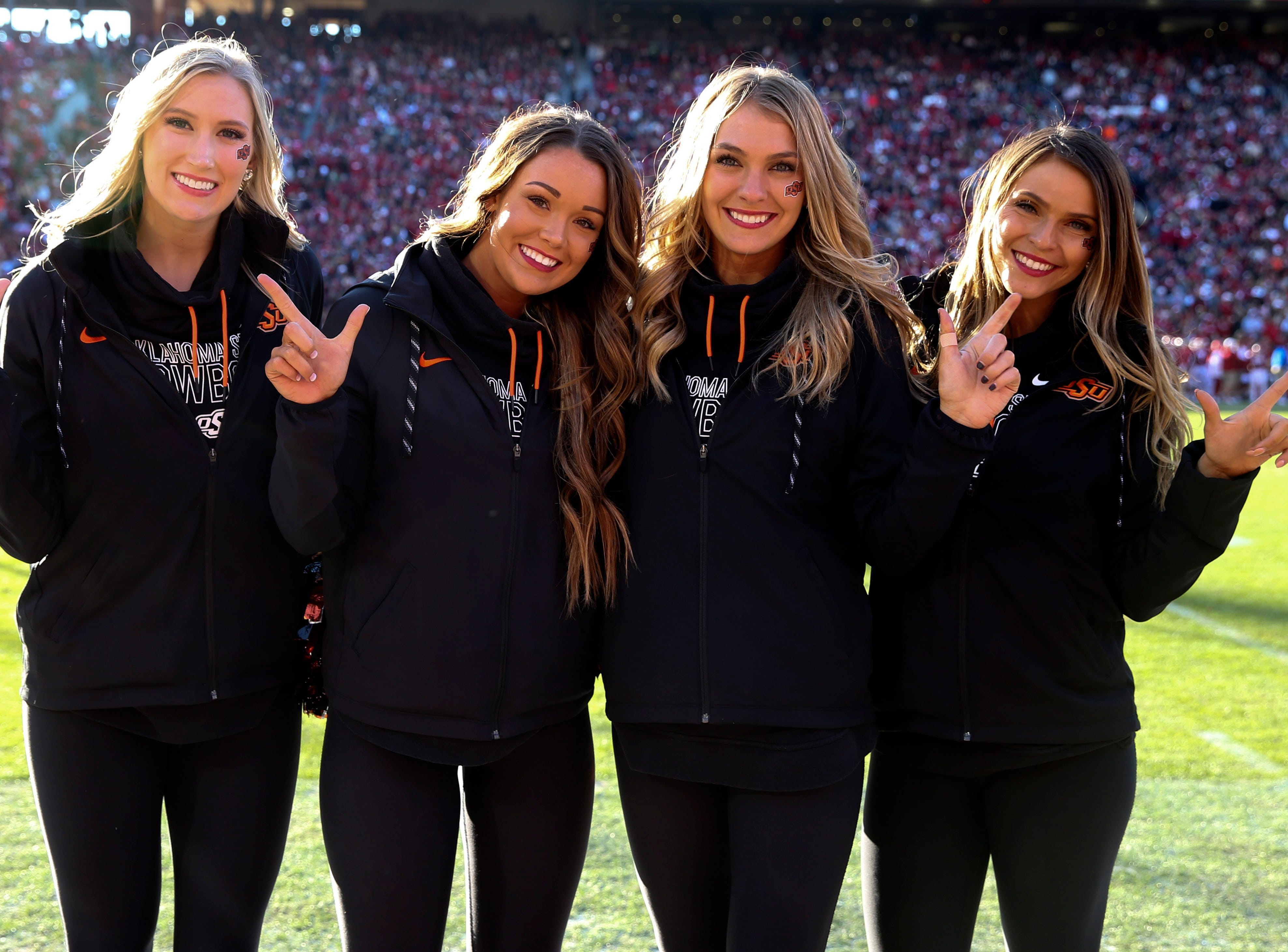Week 11: Members of the Oklahoma State Cowboys pom squad pose for a photo during the first half against the Oklahoma Sooners at Gaylord Family-Oklahoma Memorial Stadium.