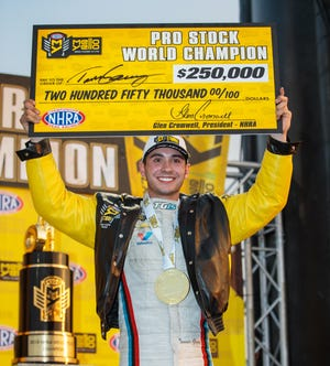 Tanner Gray celebrates after clinching the 2018 NHRA Pro Stock world championship during qualifying at Auto Club Raceway.