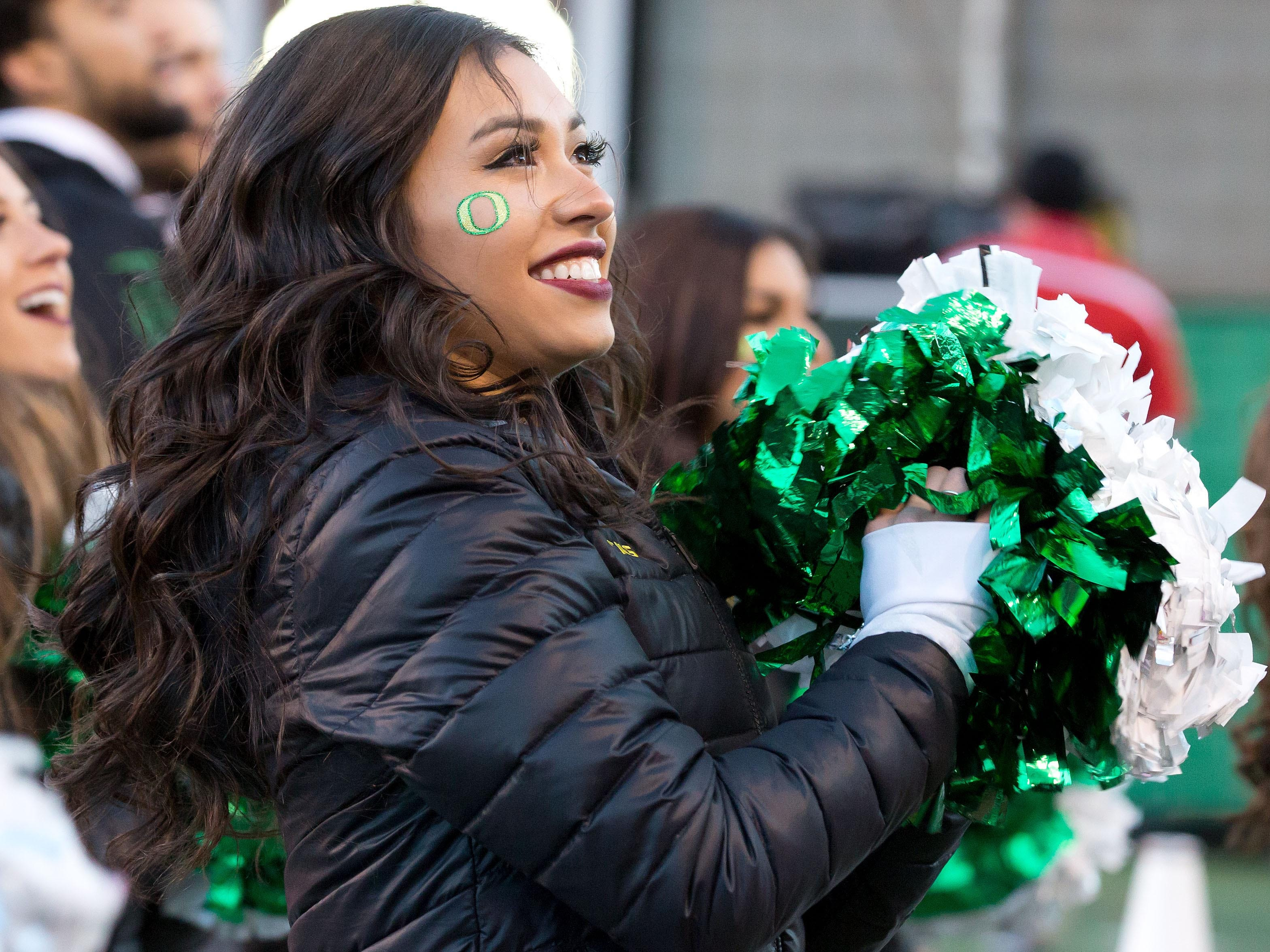 Week 11: An Oregon Ducks cheerleader performs during the first half against the Utah Utes at Rice-Eccles Stadium.