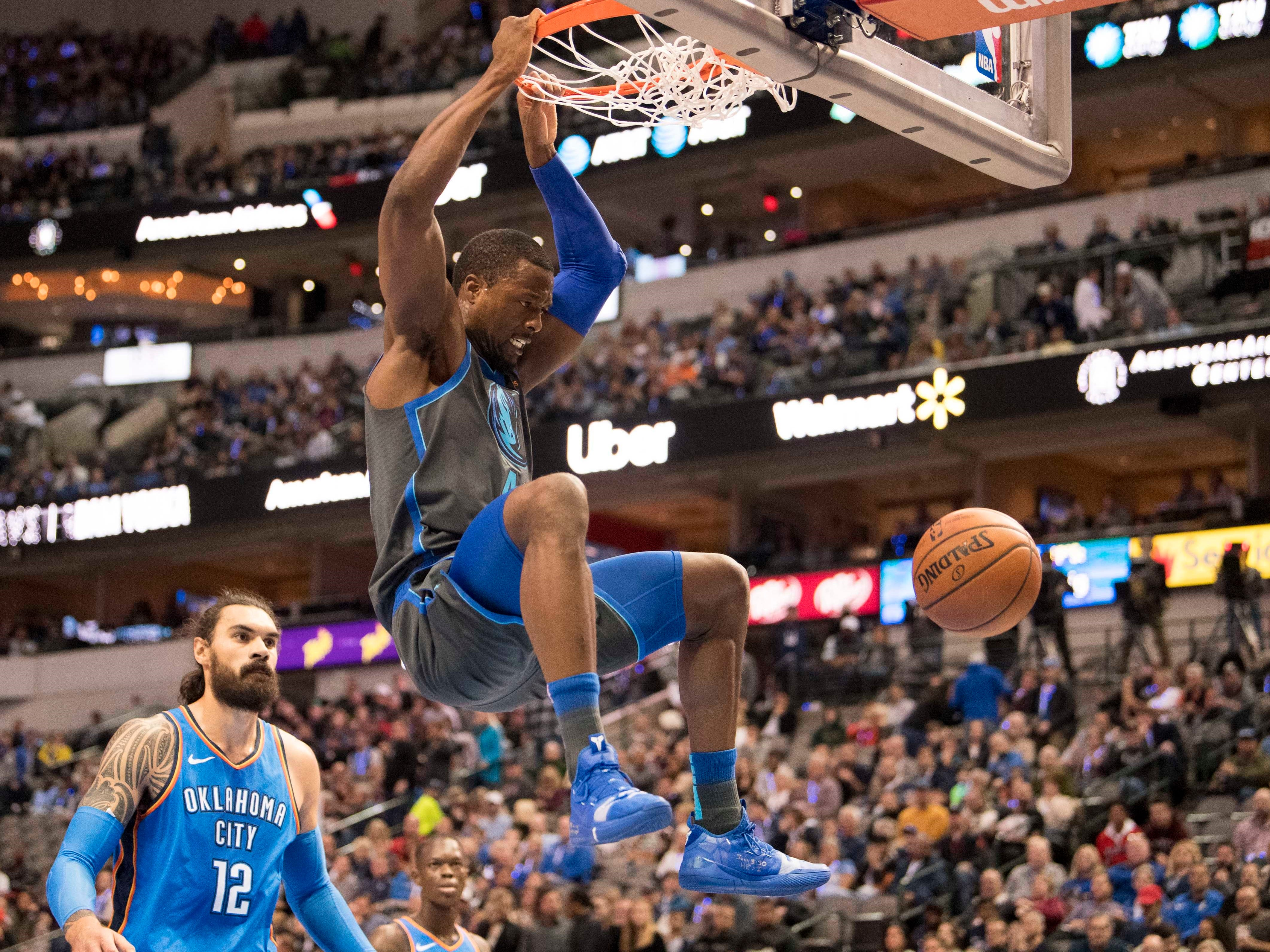Nov. 10: Mavericks forward Harrison Barnes puts down the two-handed slam during the first half against the Thunder in Dallas.