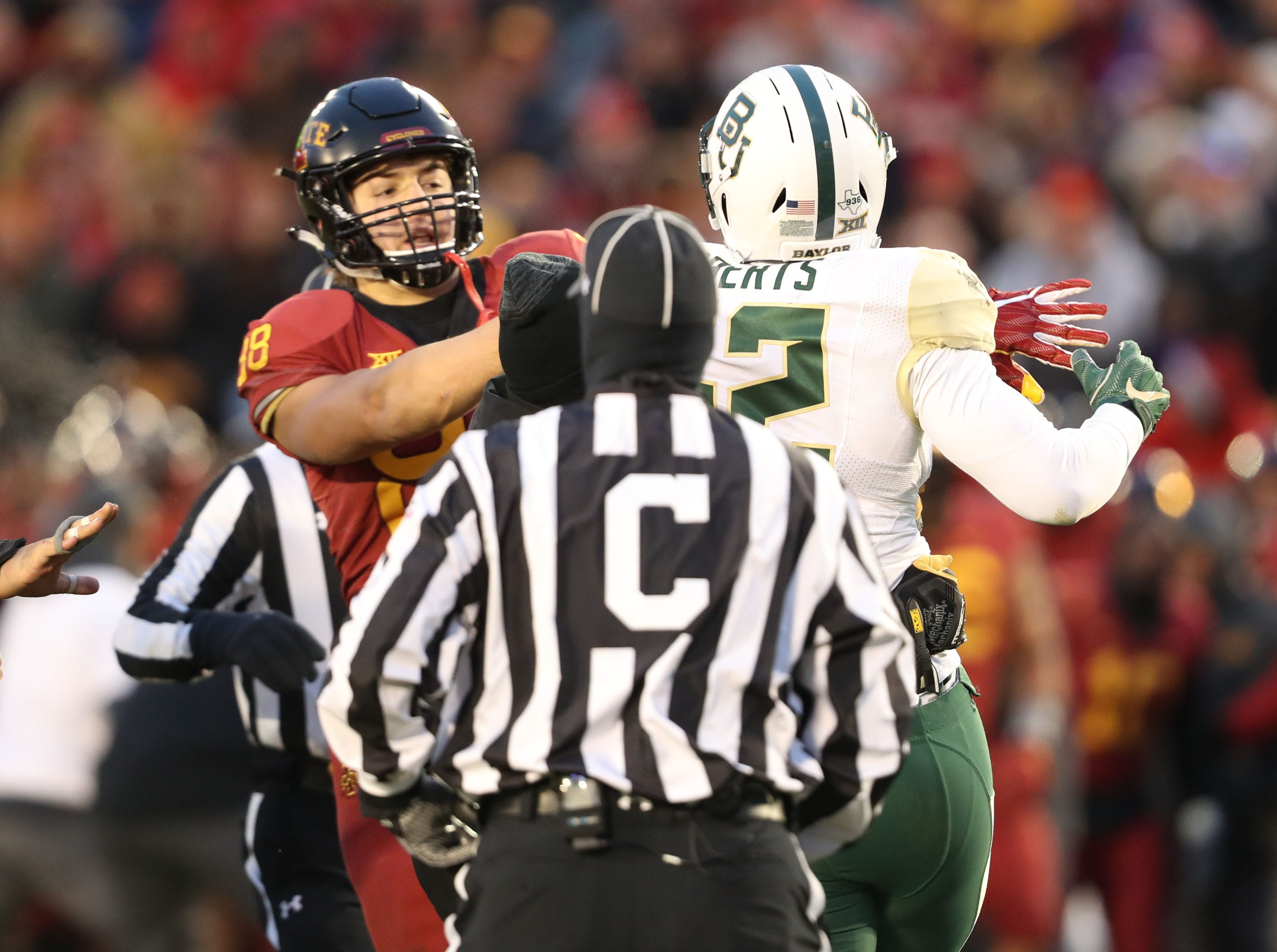 Baylor Bears defensive end Greg Roberts (52) and Iowa State Cyclones tight end Charlie Kolar (88) scuffle during their game at Jack Trice Stadium.