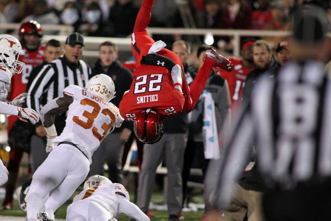 Texas Tech Red Raiders running back Seth Collings (22) is upended by the Texas Longhorns defense in the first half at Jones AT&T Stadium.