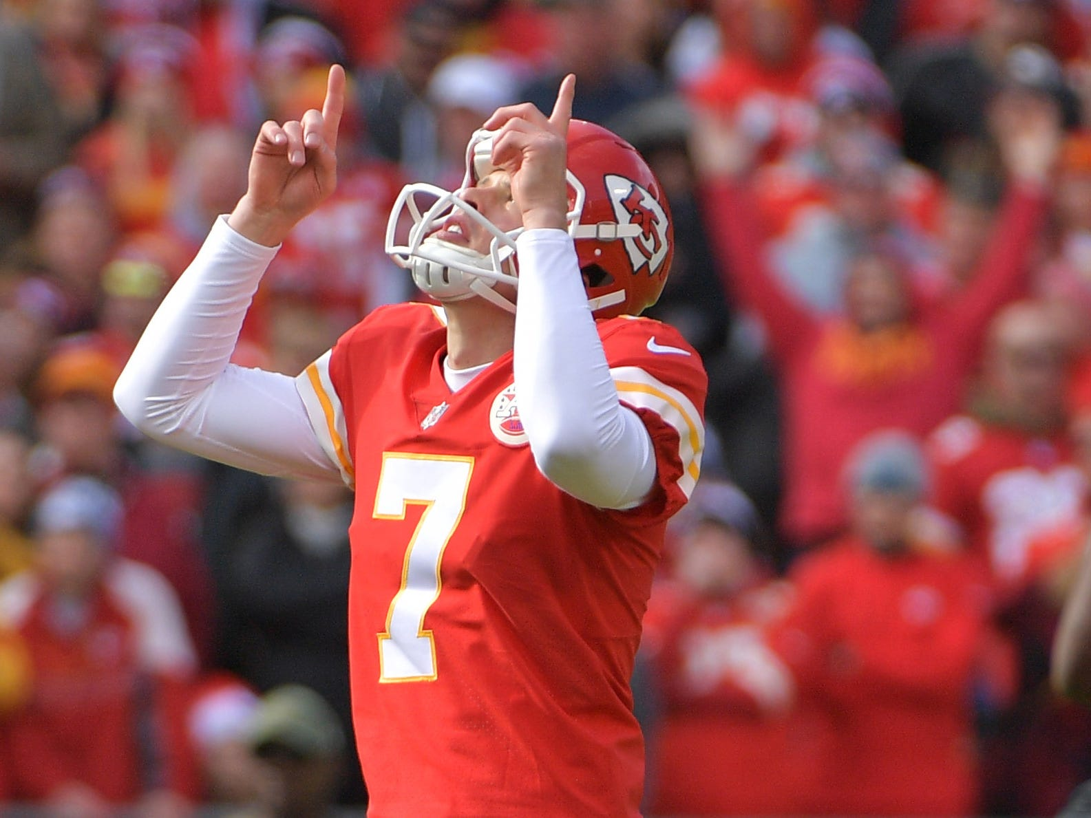 Chiefs kicker Harrison Butker celebrates after kicking a field goal.