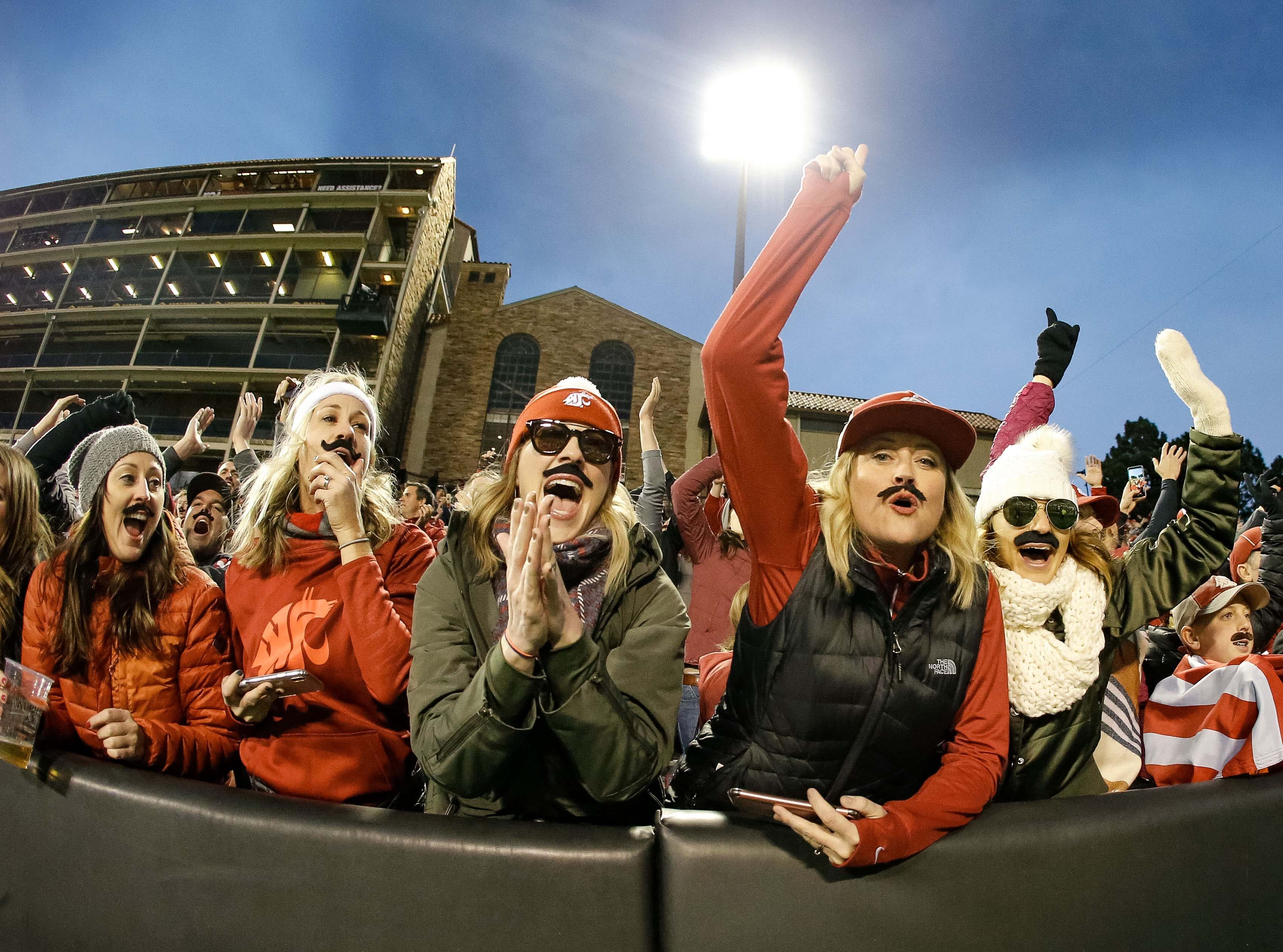 Week 11: Washington State Cougars fans react after the game against the Colorado Buffaloes at Folsom Field.