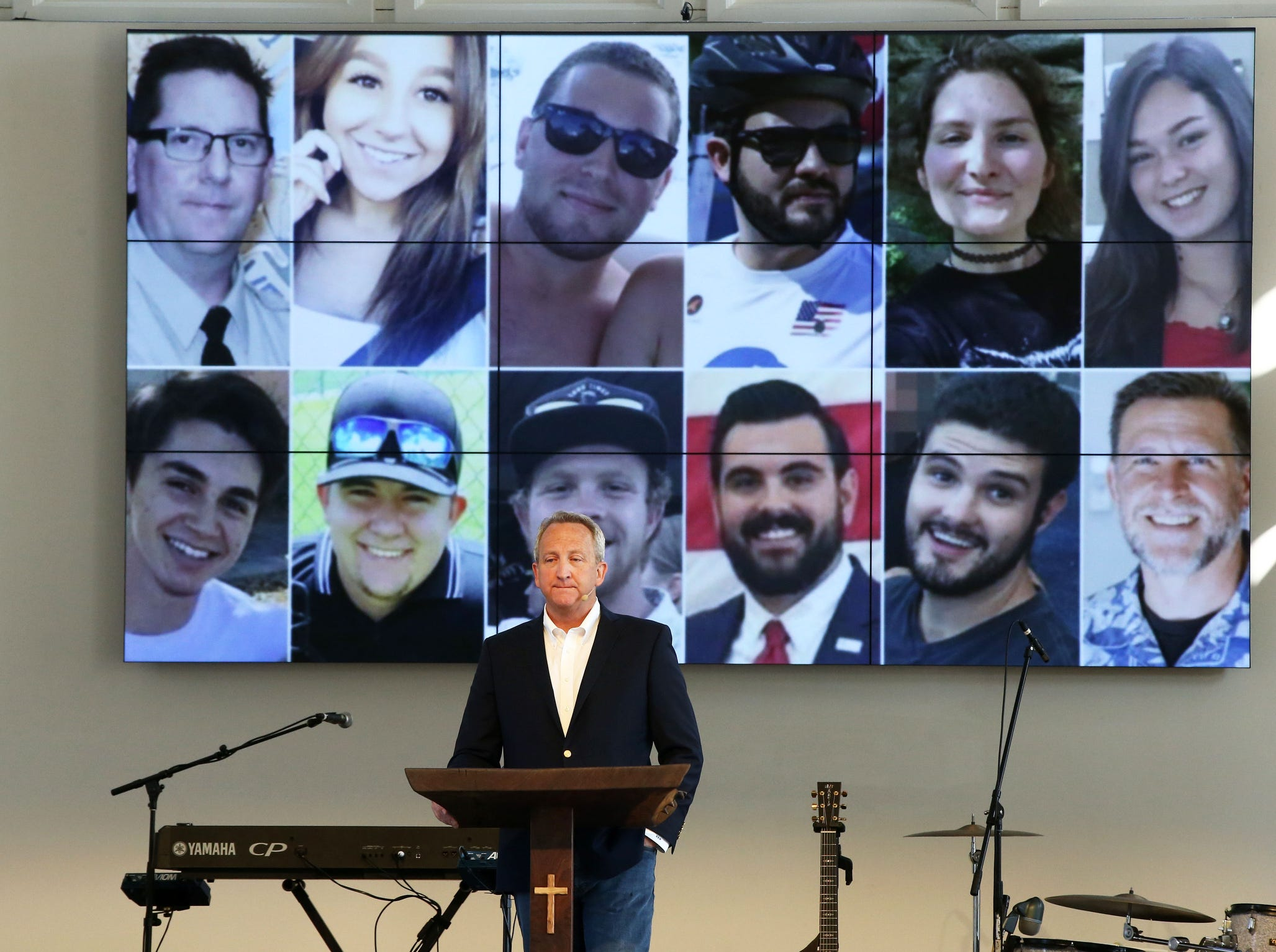 Pictures of the shooting victims at the Borderline Bar and Grill in Thousand Oaks, Calif. are shown in the sanctuary of Godspeak Calvary Chapel in Newbury Park, Calif., as councilman and pastor Rob McCoy speaks during the Sunday service.