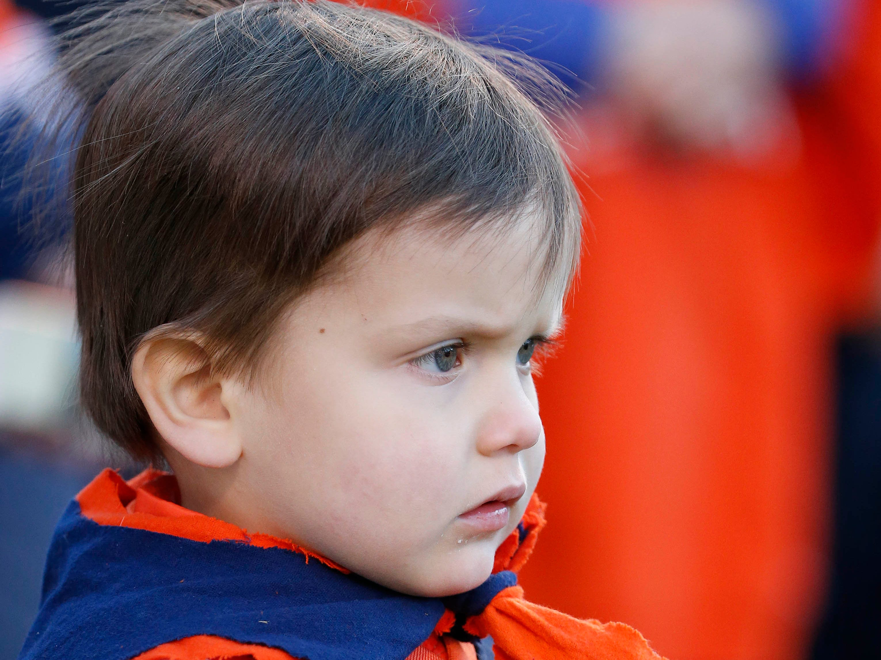 Week 11: A young Virginia Cavaliers fan looks on from the sidelines during the first half against the Liberty Flames at Scott Stadium.