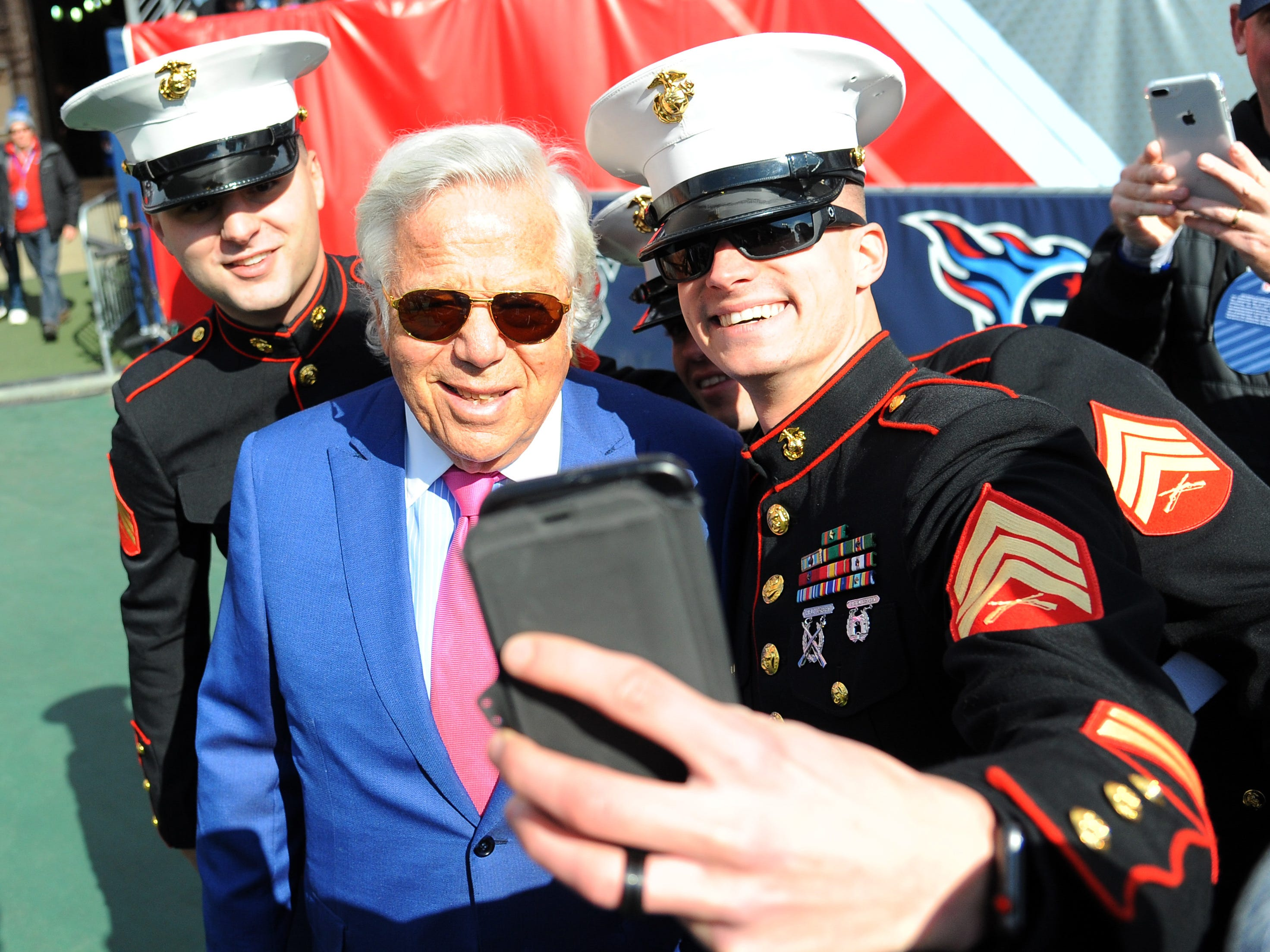 Patriots owner Robert Kraft takes a selfie with Marine Corp sergeants.