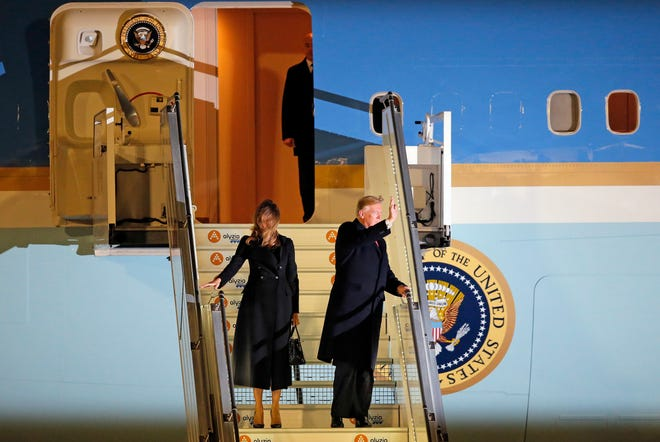 President Donald Trump and first lady Melania Trump alight from Air Force One after arriving in Paris.