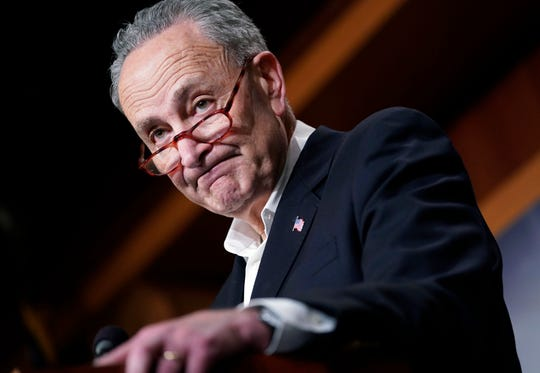 Senate Minority Leader Chuck Schumer of N.Y., pauses while speaking to members of the media at the Capitol in Washington, Nov. 7, 2018.