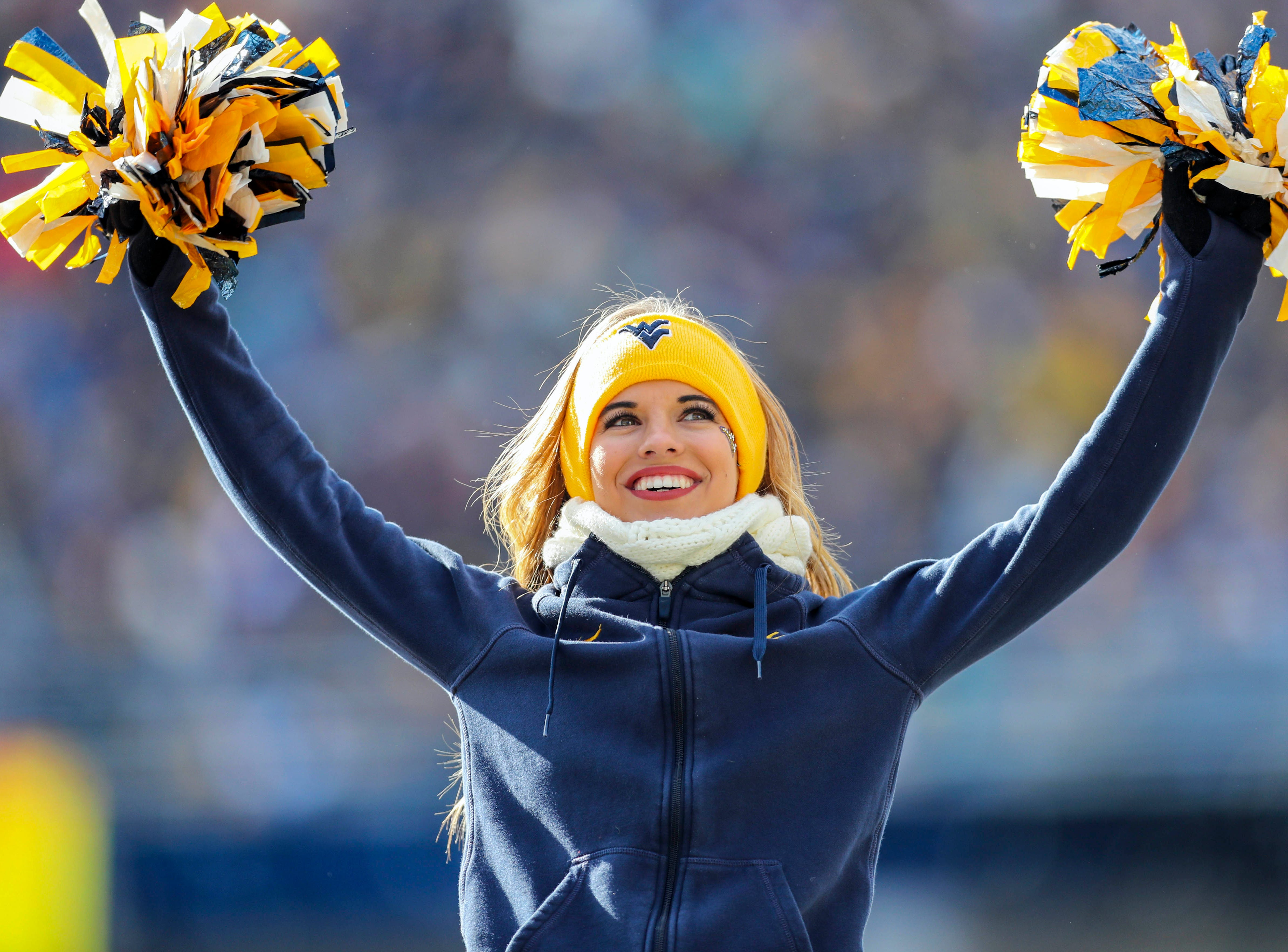 Week 11: A West Virginia Mountaineers cheerleader performs during the second quarter against the TCU Horned Frogs at Mountaineer Field at Milan Puskar Stadium.