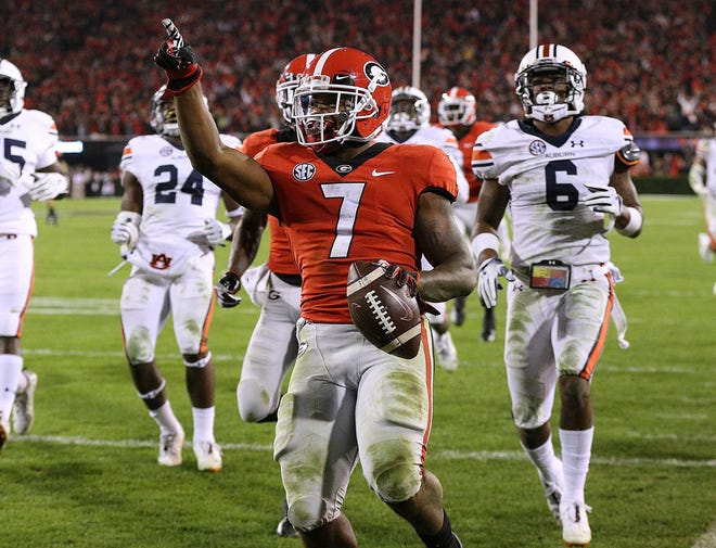 Georgia running back De'Andre Swift, seen here celebrating his 77-yard TD in Saturday's 27-10 win over Auburn, won co-SEC Offensive Player of the Week honors on Monday.