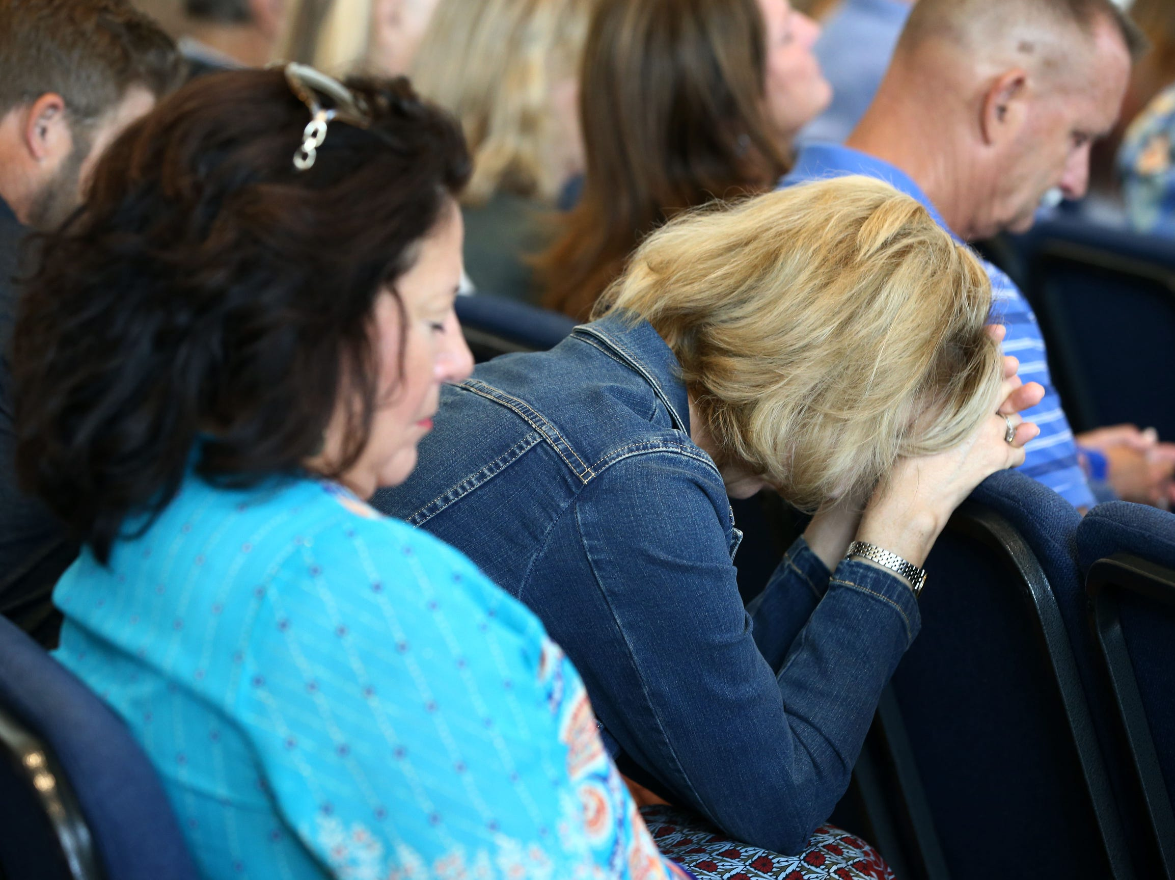 The congregation, which includes fire and shooting survivors and victim families, pray during Sunday morning services at Godspeak Calvary Chapel, Sunday, in Newbury Park, Calif.