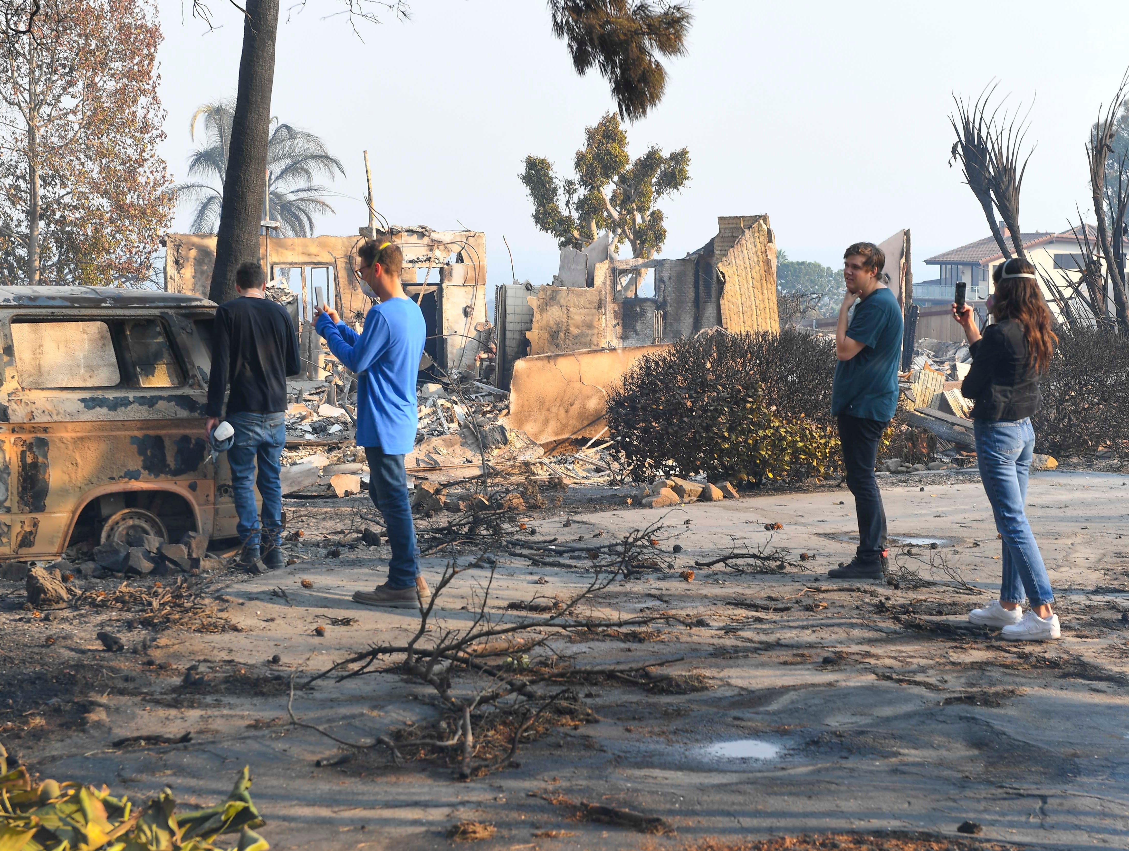 Residents look over the damage to a home on Dume Road in Malibu, Calif, which was overrun by the Woosley Fire. The Woosley Fire as of Nov.10, 2018 has consumed 70,000 acres.