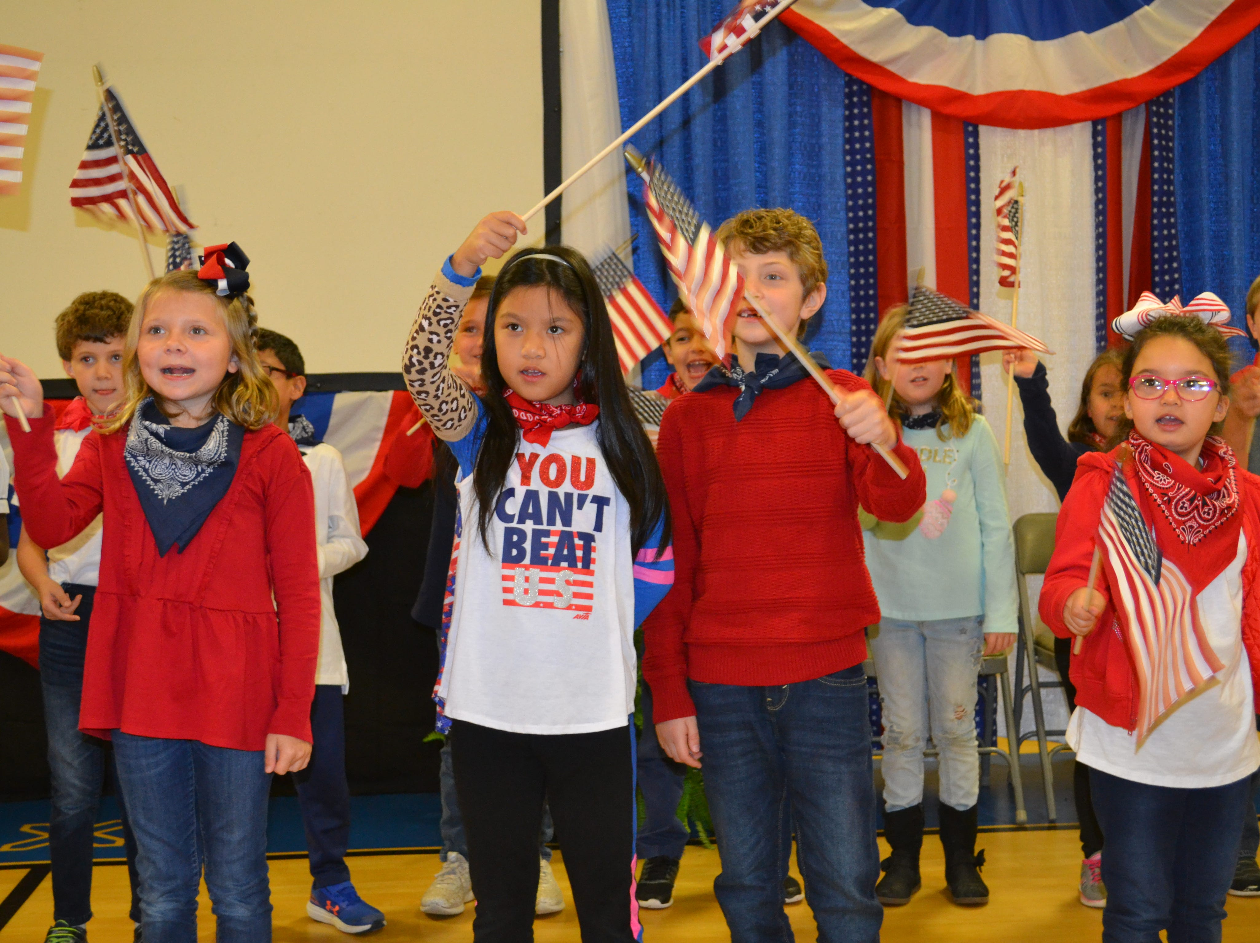 """Members of the 2nd grade music class sing """"This Is My Country"""" at Alexandria Country Day School Monday for a special Veteran's Day program. Students could invite friends and family members who are veterans to attend the special presentation."""